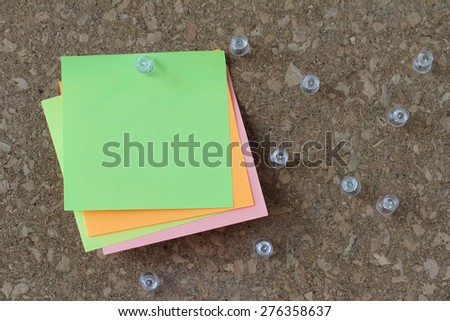 pin board and blank sticky note on cork board as concept - stock photo