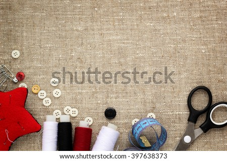 pin cushion with needles,thread and buttons for sewing - stock photo