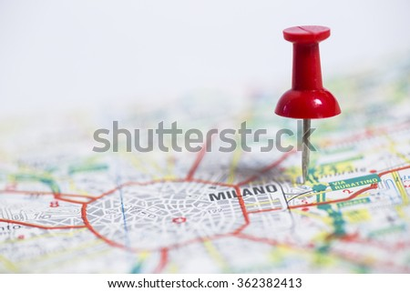 Pin indicates the destination on the road map - Milano (Italy) - stock photo