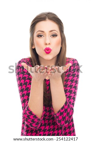 Pin-up blowing kisses at camera - stock photo