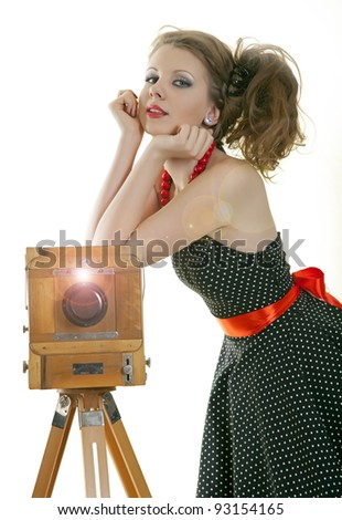 Pin-up girl and vintage camera - stock photo