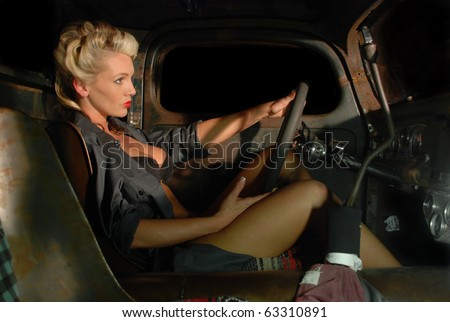 Pin Up Girl Driving a Classic Truck - stock photo
