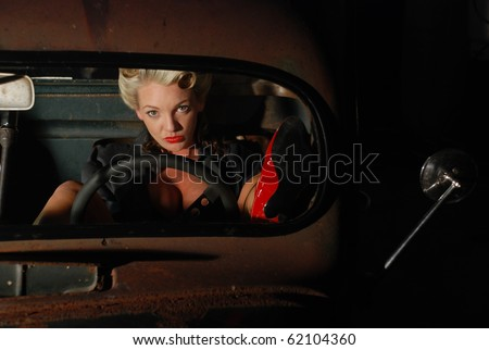 Pin Up Girl in a Classic Rat Rod Car - stock photo