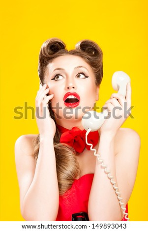 Pin-up girl talking on retro telephone - stock photo
