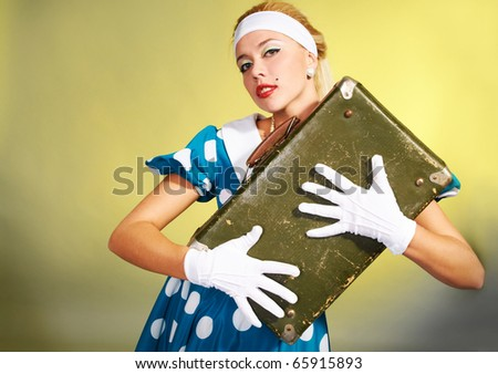 Pin up girl with a suitcase - stock photo