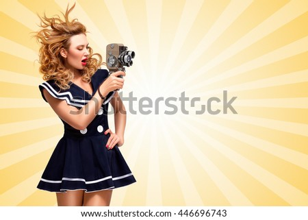 Pin-up sailor girl shooting a movie with an old cinema 8 mm camera on cartoon style background. - stock photo