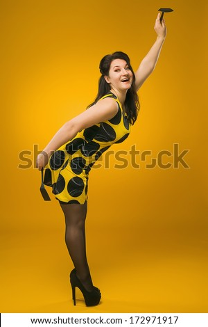 Pin-Up. Sexy housewife. Vintage. Retro. Brunette in stockings. - stock photo