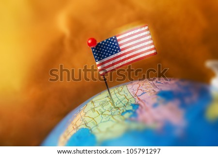Pin with USA flag on a globe - stock photo