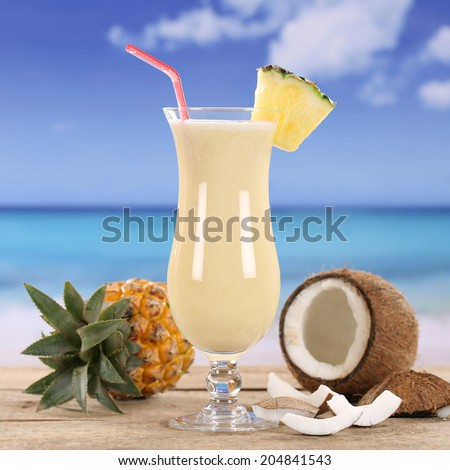 Pina Colada cocktail drink with fruits on the beach - stock photo