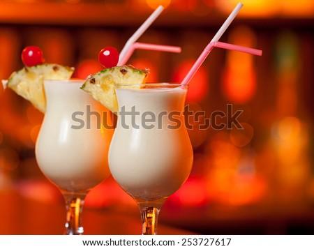 Pina Colada cocktail on a bar - stock photo
