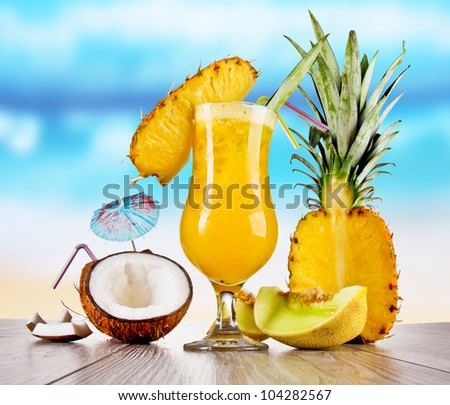 Pina colada drink with blur beach on background - stock photo