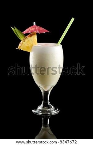 Pina colada isolated on a black background. - stock photo