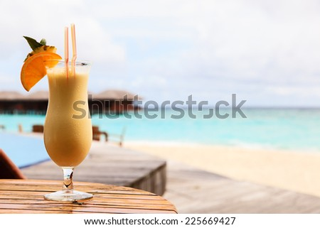 pina colada on tropical beach vacation - stock photo