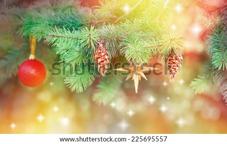 Pine cones and Christmas symbols on Christmas tree - stock photo