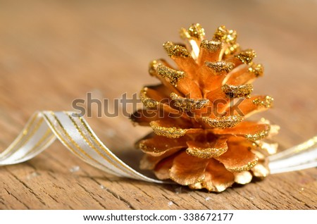 pine cones Christmas decoration on wooden table - stock photo
