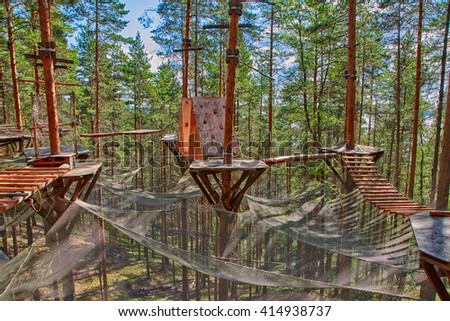 Pine Forest Rope Park Challenge and Puzzle - stock photo