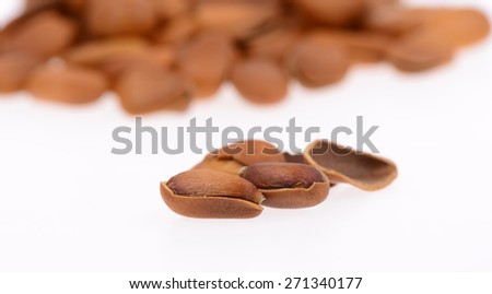 Pine nuts on a white background, close-up  - stock photo