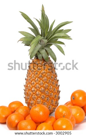 pineapple and tangerines on white background - stock photo