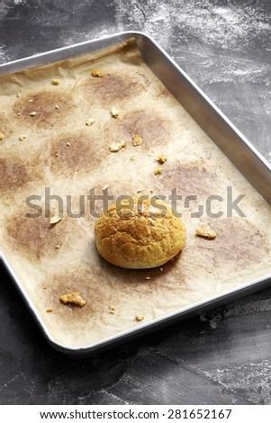 Pineapple Bread in empty plate, on the black board - stock photo