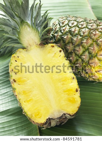 Pineapple cut in half - stock photo