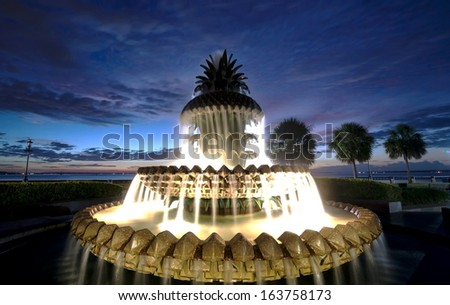 Pineapple fountain in the early hours right before the sunrise - stock photo