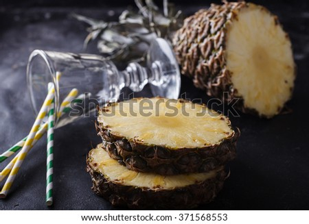 Pineapple ,fresh and ripe sliced on a dark background.A tropical fruit. - stock photo