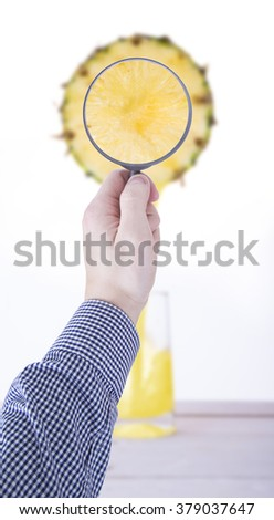 Pineapple juice pouring into a glass - stock photo