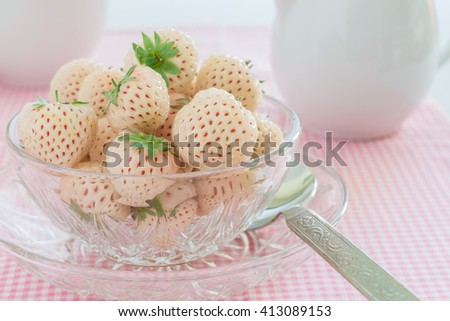 Pineberry or Hula Berry a hybrid strawberry with a pineapple flavor white flesh and red seeds - stock photo