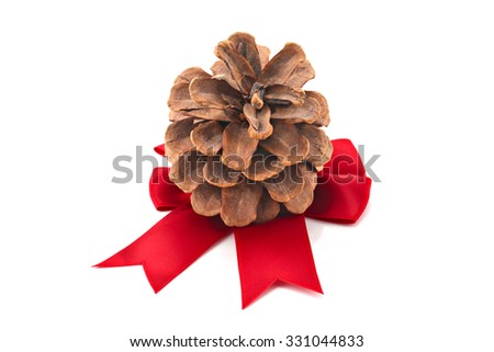 Pinecone with Christmas ribbon isolated on white, shallow focus - stock photo
