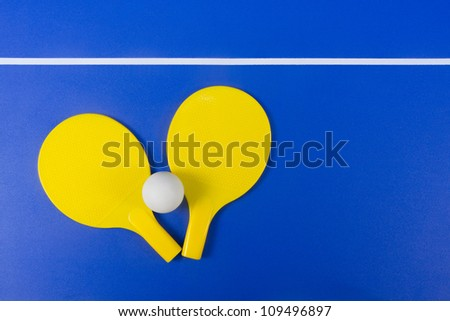 Ping-pong equipment on the game table - stock photo