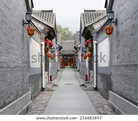 PINGYAO, CHINA - FEBRUARY 2: view of decorated street during Spring Festival on February 2, 2013 in Pingyao, China. Streets are decorated with red lanterns to bring good luck for the New Year. - stock photo