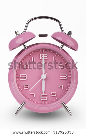Pink alarm clock with the hands at 6 am or pm isolated on a white background. - stock photo
