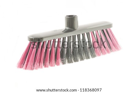 pink and black broom on a white background - stock photo