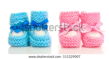 pink and blue baby boots isolated on white - stock photo