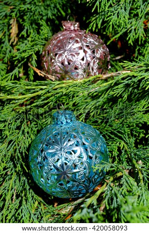 Pink and blue Christmas balls on green pine needles - stock photo