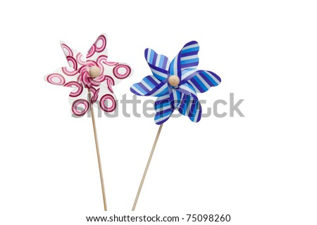 Pink and blue paper windmills on a white background - stock photo