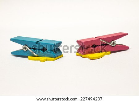pink and bule  color wood peg on white background - stock photo