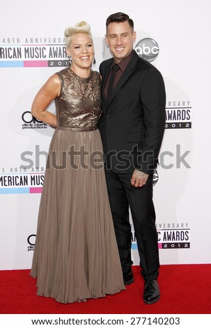 Pink and Carey Hart at the 40th Anniversary American Music Awards held at the Nokia Theatre L.A. Live in Los Angeles, United States, 181112.  - stock photo