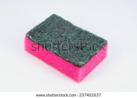 Pink and green kitchen scrub. Kitchen sponge. - stock photo
