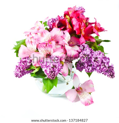 Pink and violet flowers in vase. Lilac and alstroemeria - stock photo