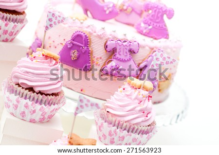 pink and violet girl's birthday cake on the plate - stock photo