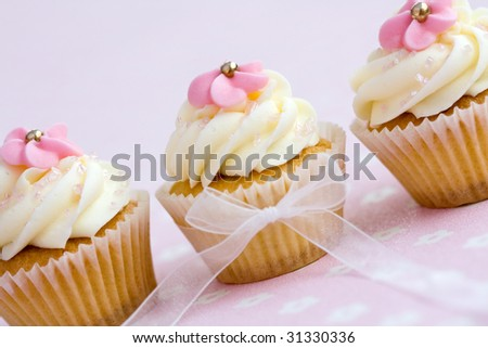 Pink and white cupcakes - stock photo