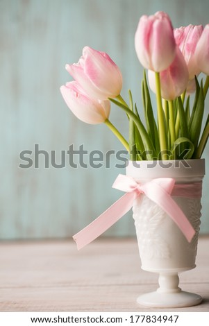 Pink and White tulips in white vase - stock photo