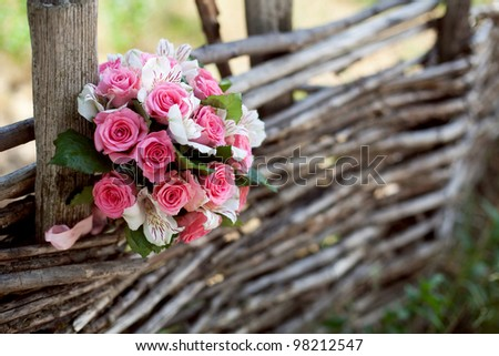 pink and white wedding bouquet of roses on the tree - stock photo