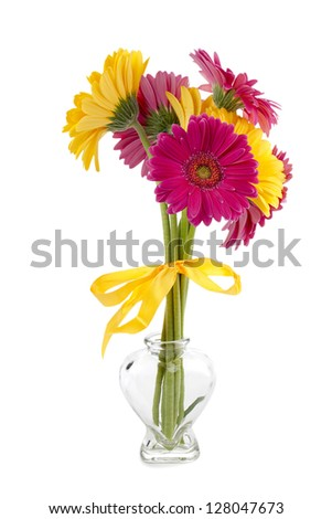 Pink and yellow Gerbera Daisy flowers on a glass vase - stock photo