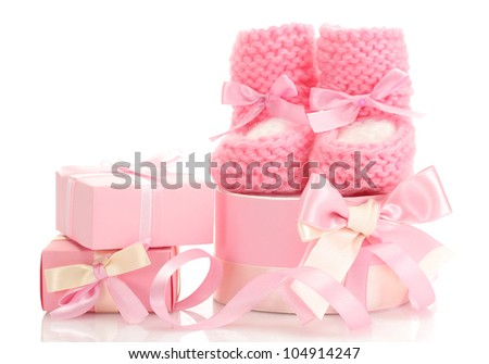 pink baby boots and gifts isolated on white - stock photo