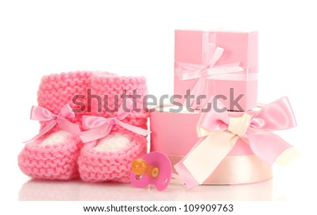 pink baby boots,  pacifier and gifts isolated on white - stock photo