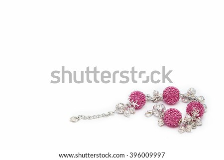 Pink beaded bracelet in the corner - stock photo