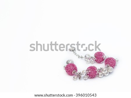 Pink beaded bracelet in the right corner - stock photo