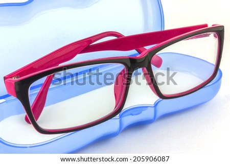 Pink-Black nerd spectacle frames on isolated white background - stock photo